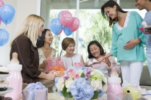 pregnant woman and friends at a baby shower